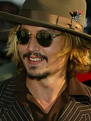 Johnny Depp Shows Off His Gold Teeth At The Pirates Premiere Click On Photo For Gallery C Reuters